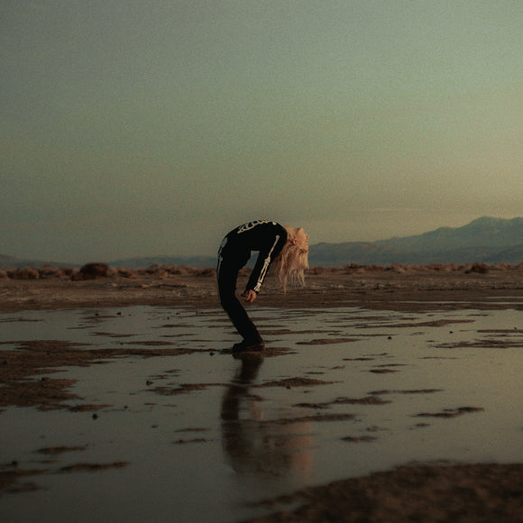Copycat Killer by Phoebe Bridgers & Rob Moose on Dead Oceans Records (the album sleeve is a photograph of Phoebe Bridgers bending over backwards on wet sand wearing a skeleton suit beneath a clear sky