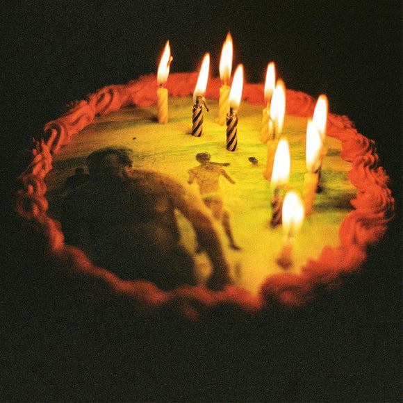 Happy Birthday Ratboy by Ratboys on Topshelf Records (the album cover is a grainy colour photograph of a birthday cake in the dark with ten candles on it; on the top of the frosted cake is an image of a beach scene).