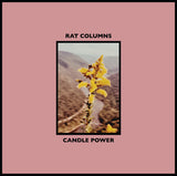 Candle Power by Rat Columns on Upset The Rhythm Records (the album sleeve is pink with a rectangular photograph in the centre depicting a yellow plant against an out of focus landscape; the band name is printed in black uppercase text above the photo, and the title is in the same type below the photo).