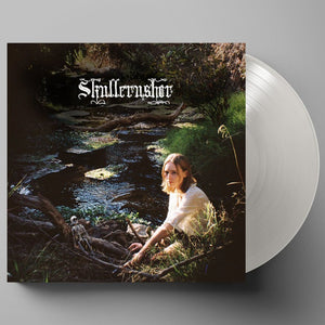 Skullcrusher's debut self-titled EP (the artwork is a  photograph of a sun-dappled scene in which Helen Ballantine sits beside a stream and looks sideways at the camera; infront of them, resting on some branches that lay across the babbling water is a small model of a human skeleton. The artist name is written in an ornate font, resembling a heavy metal logo)