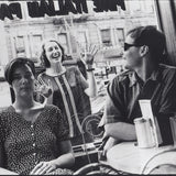 Black and white photograph of Stereolab in a cafe