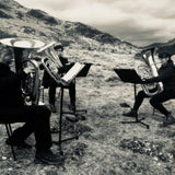 Photograph of The Viaduct Tuba Trio playing on a hillside
