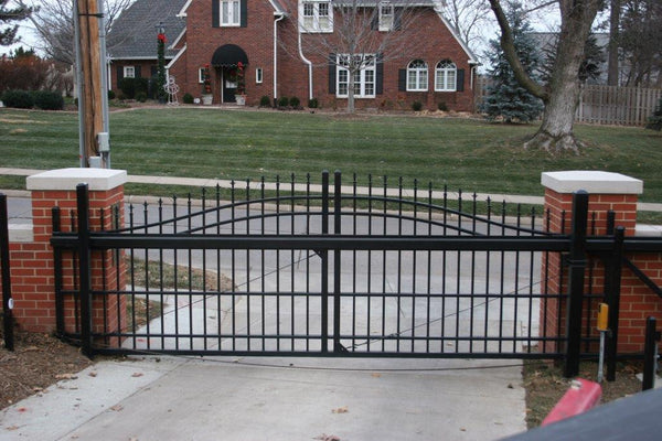 Ornamental sliding cantilever gate in front of a driveway