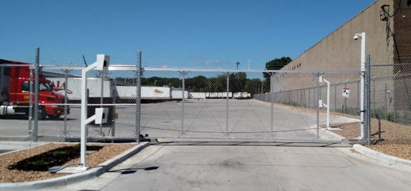 High security chain link cantilever gate with barb wire and automated access controls