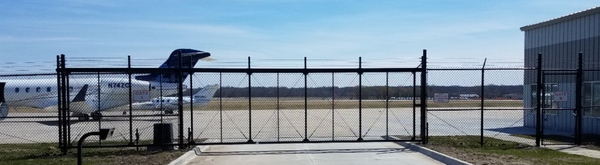 Airport runway secured by a cantilever slide gate with gate automation
