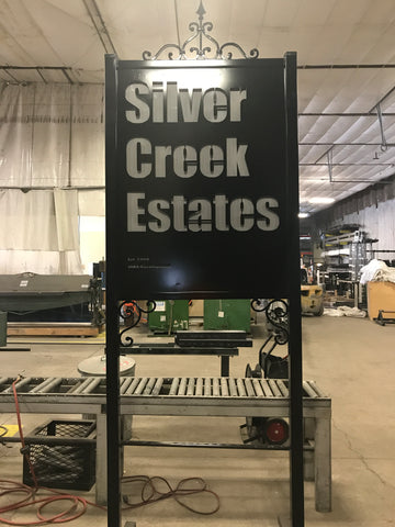 Custom ornamental sign for Silver Creek Estates utilizing a shadow effect and use of blank space