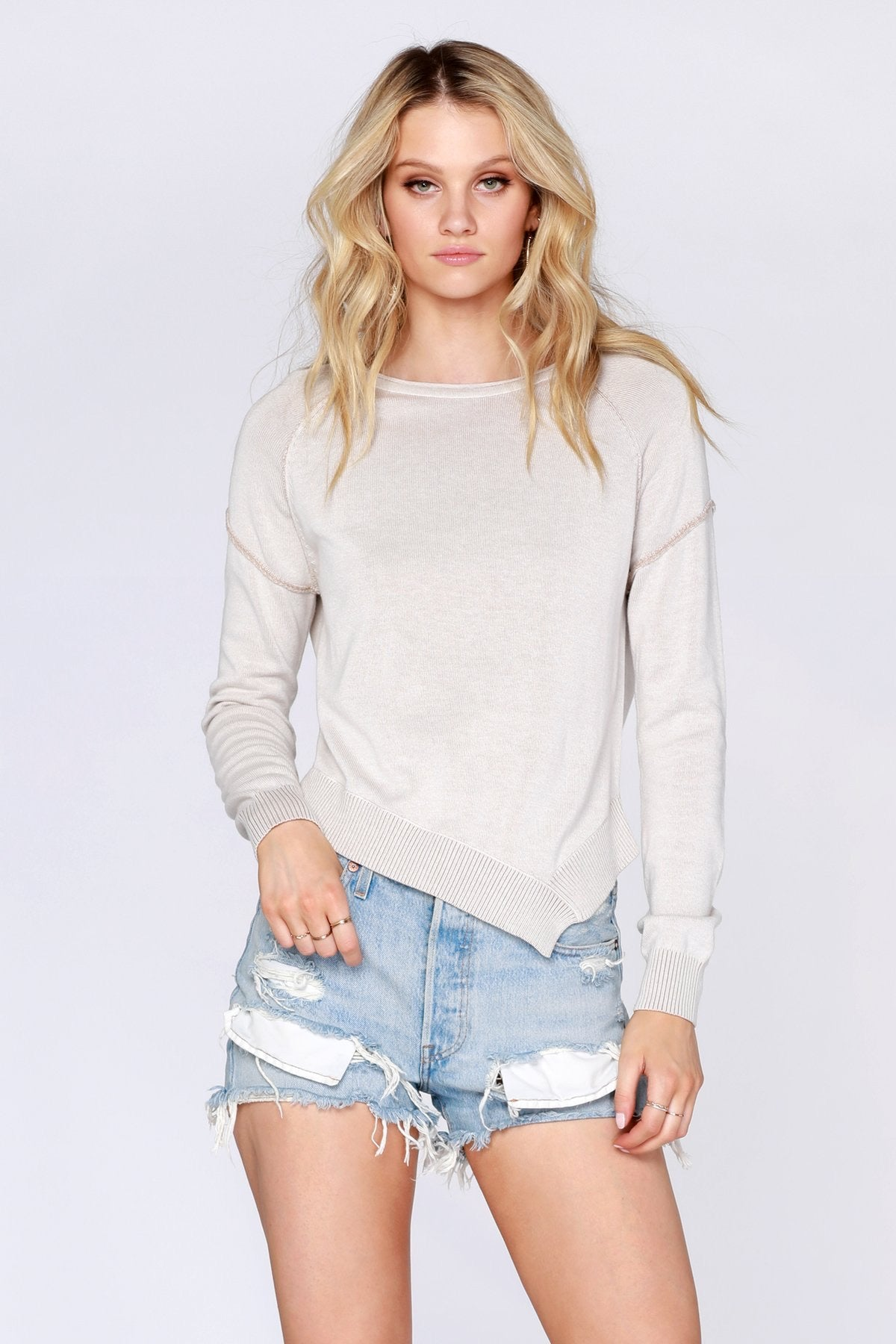 Plaited Asymmetrical Hem Sweater