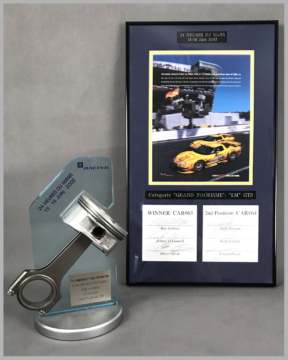 2002 - 24 Heures Du Mans Piston and Rod Assembly with ad copy autographed by drivers