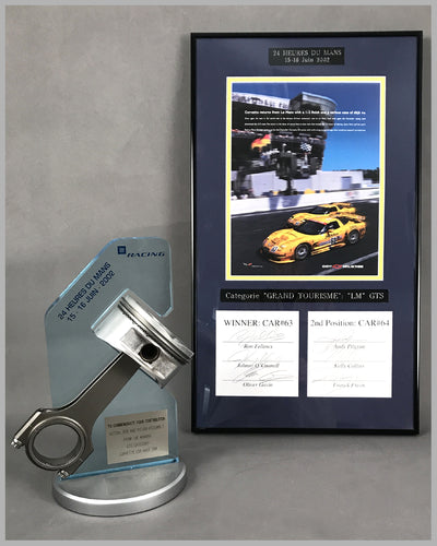 2002 - 24 Heures Du Mans Corvette Piston and Rod Assembly with ad copy autographed by drivers