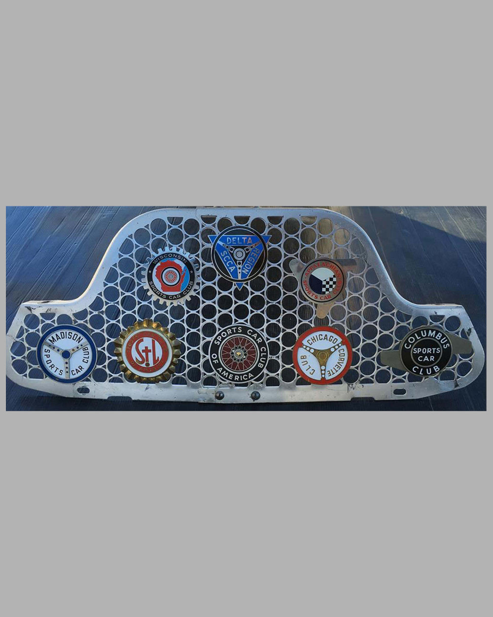 Collection of 8 U.S. Sports car club badges from the 1950's and 1960's