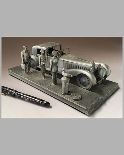The Bugatti Royale Pewter Sculpture by Raymond Meyers, detailing wealthy couple and driver with luggage
