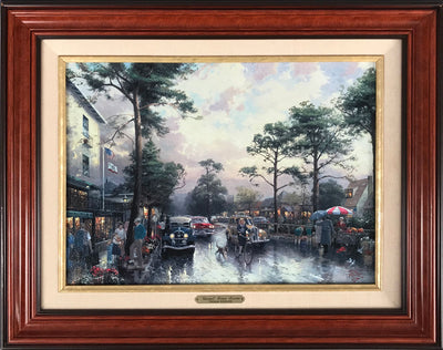 Carmel, Ocean Avenue on a rainy afternoon print on masonite by Thomas Kinkade