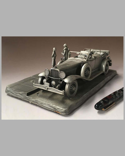 The Duesenberg Model J Pewter Sculpture by Raymond Meyers, left side and front