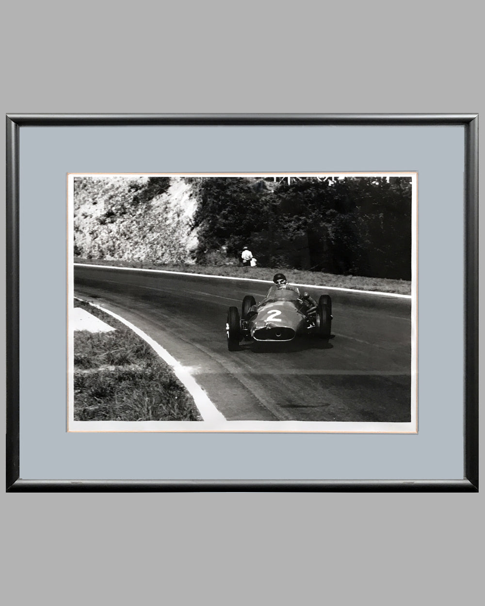 Juan Manuel Fangio in his Maserati 250F b&w photograph by Fernando Gomez