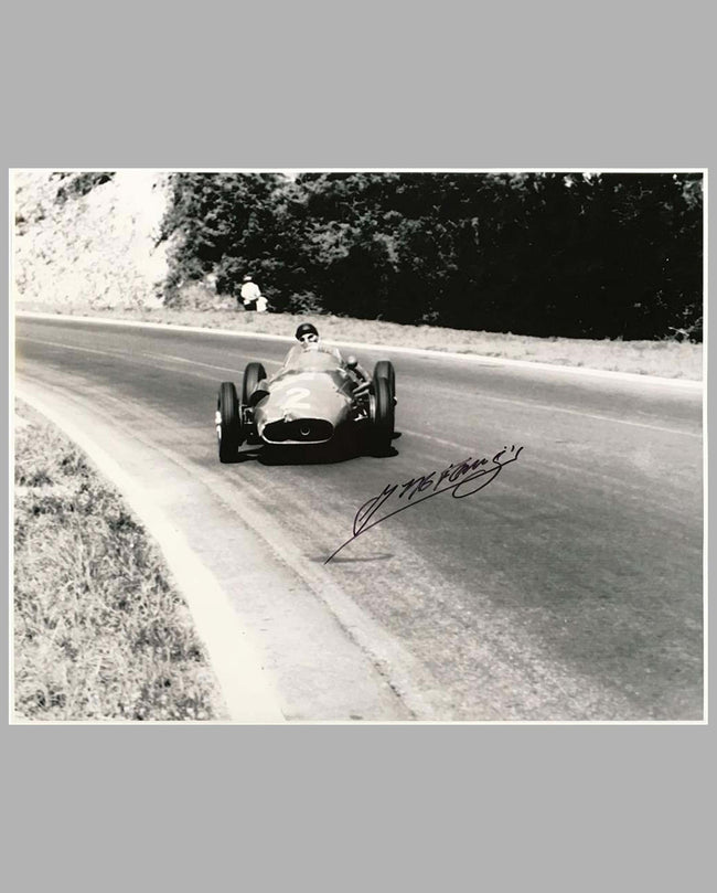 Juan Manuel Fangio in his Maserati 250 F autographed b&w photograph