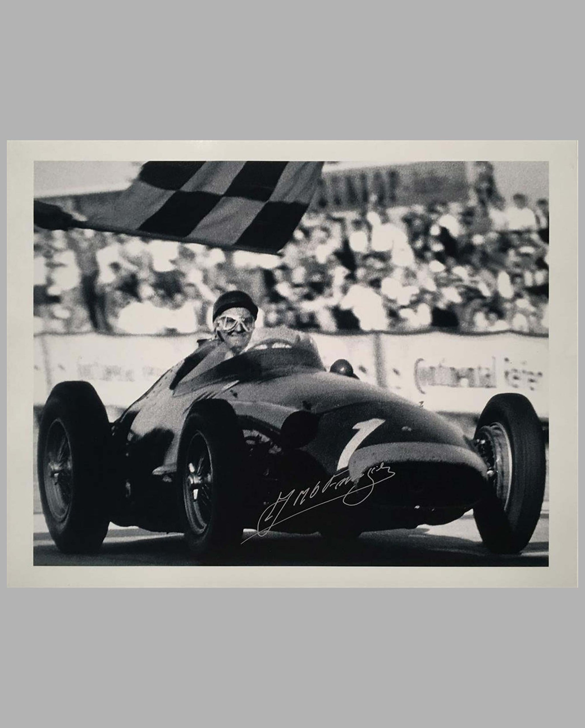 Juan Manuel Fangio Maserati 250F taking the checkered flag, b&w autographed Fangio photograph by Fernando Gomez
