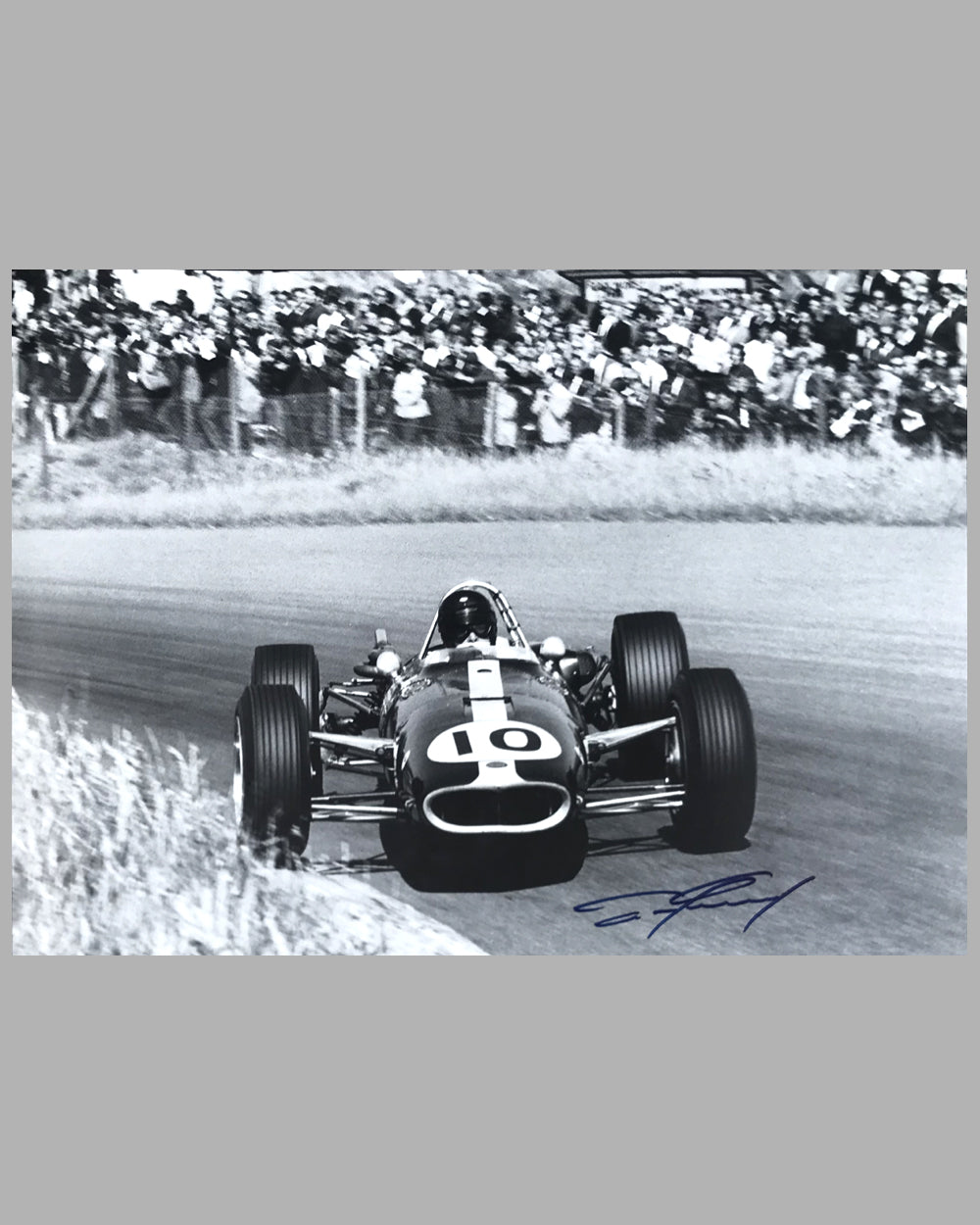 Dan Gurney autographed photograph in his Eagle Climax Formula 1 car
