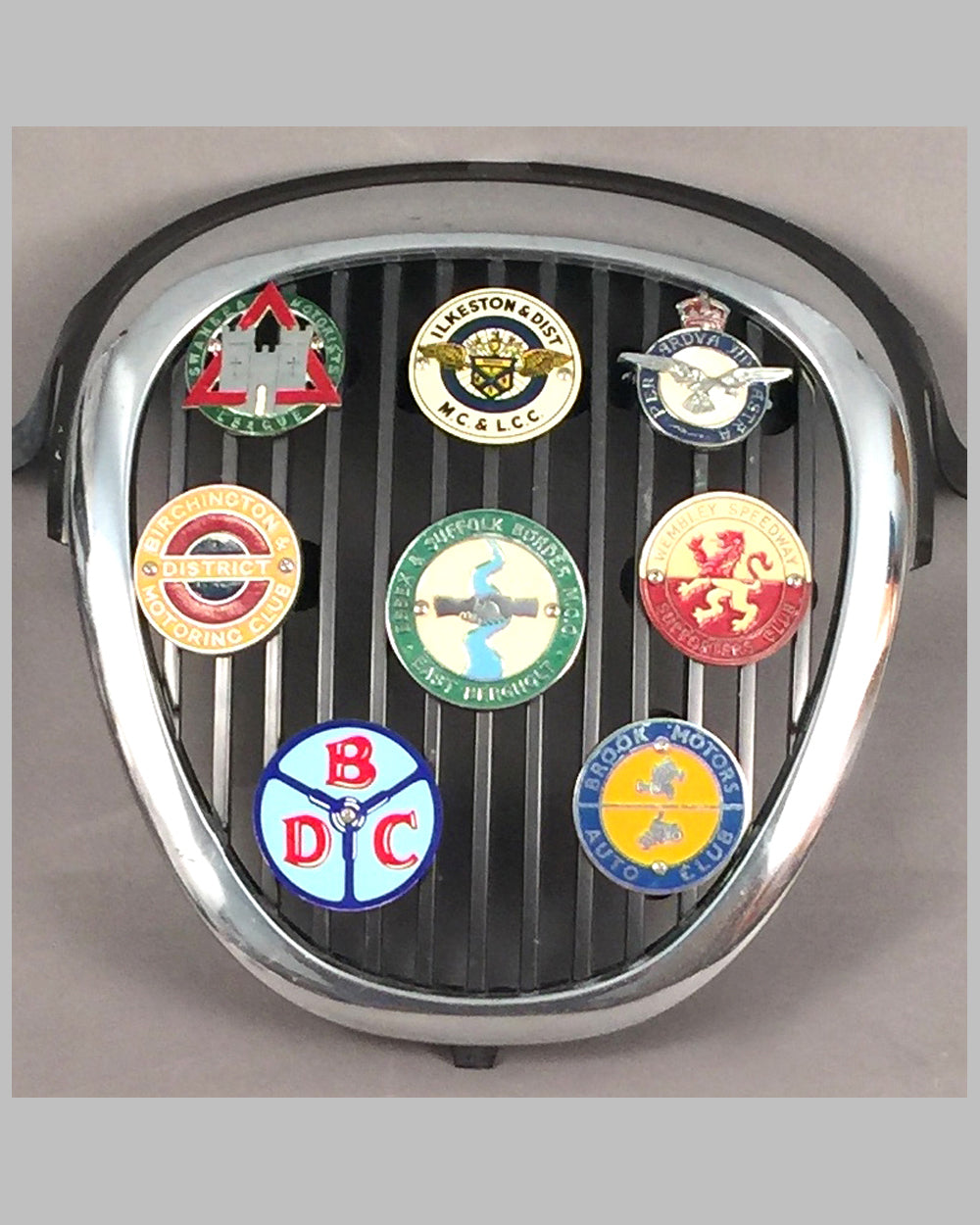 Jaguar S Type front grill with 8 British club badges displayed