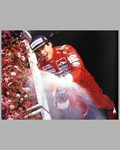 Color photographs of Ayrton Senna and his McLaren MP4 Honda 2