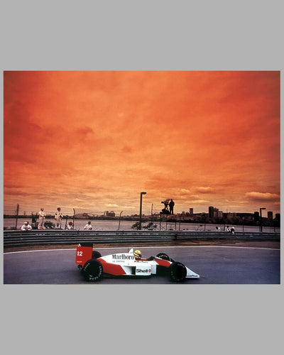 Color photographs of Ayrton Senna and his McLaren MP4 Honda 3