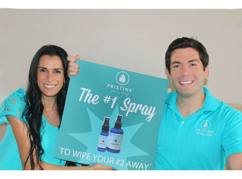 Pristine founders and co-owners posting with #1 spray to wipe #2 away sign