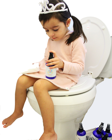 Young child on toilet, potty training, holding bottle Pristine toilet paper spray, spraying toilet paper