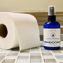Cooling Peppermint Pristine toilet paper spray wet wipe alternative on countertop with toilet paper