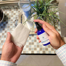 Pristine toilet paper spray wet wipe alternative, hand spraying Pristine on to toilet paper