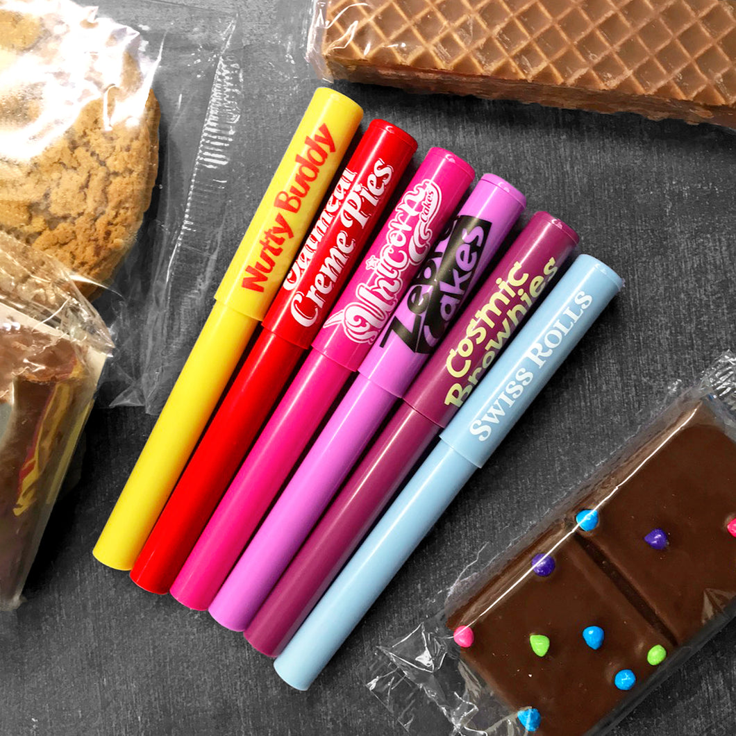 Little Debbie® Multi Variety Pen Set! This acrylic pen set has six (6) different iconic Little Debbie treats including: Nutty Buddy® Bars, Oatmeal Creme Pies, Unicorn Cakes, Zebra® Cakes, Cosmic® Brownies and Swiss Rolls. Each pen has a cap and the ink color is black. Grab a set today and be back to school ready!