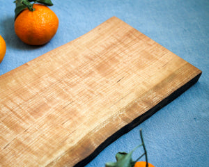 Natural Edge Cherry Cutting Board with Butterfly Inlays
