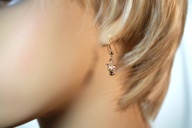 Small Leopard Head Dangle Earrings on model ear