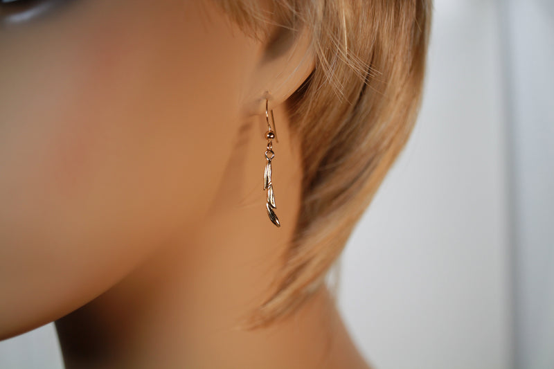 Gold Rice Earrings in 14kt Gold Vermeil on model ear