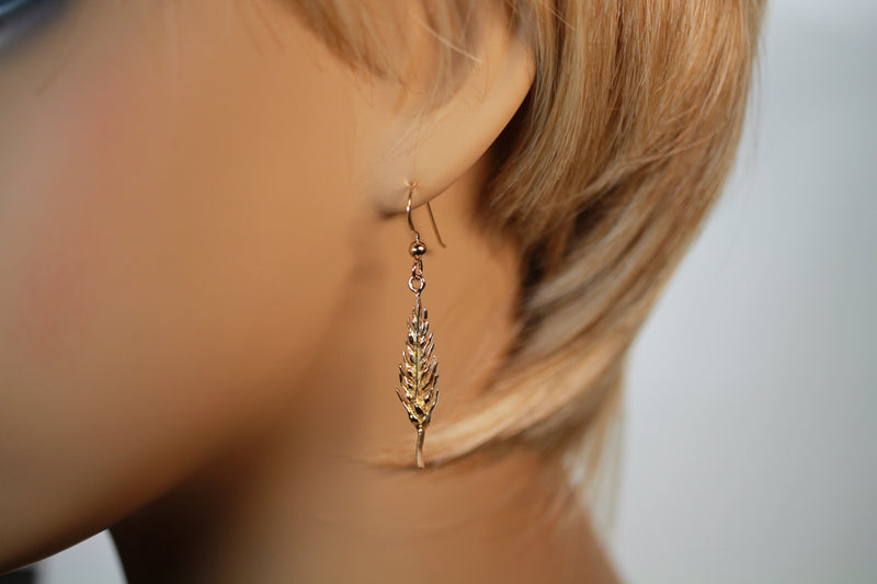 Gold Vermeil Wheat Head Dangle Earrings on model ear