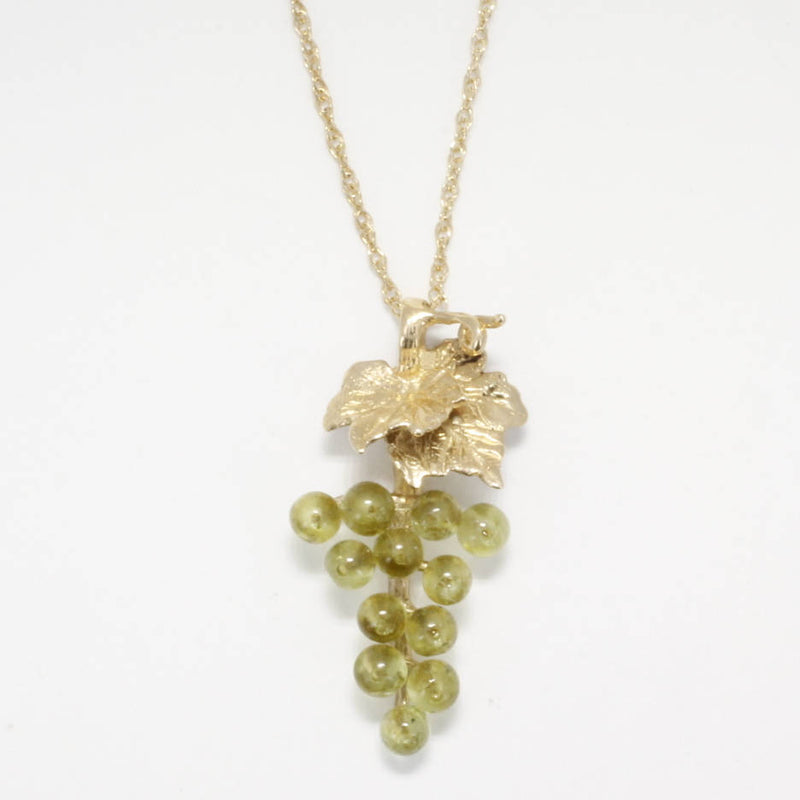 peridot grape cluster necklace with 14kt yellow gold grape leaf