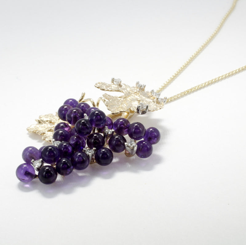 Amethyst necklace in 14kt gold with diamonds by agrijewelry.com