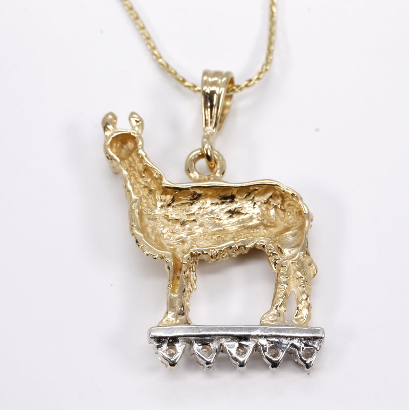 "Llama Necklace in 14kt. gold with diamonds on Lighted Stage on 18"" chain"