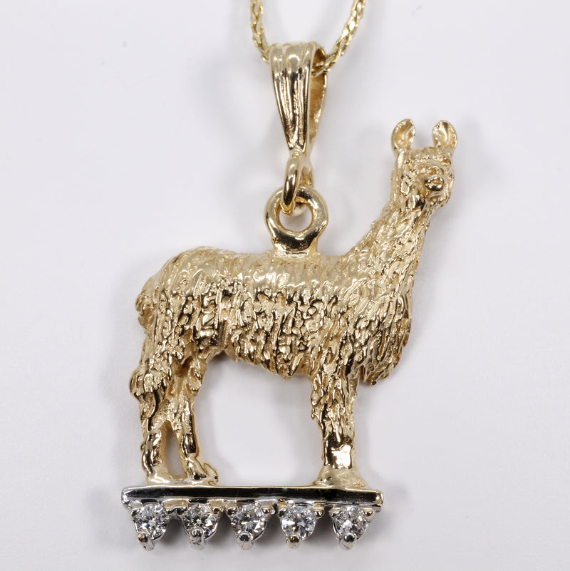 Suri Alpaca Necklace on lighted stage with Diamonds