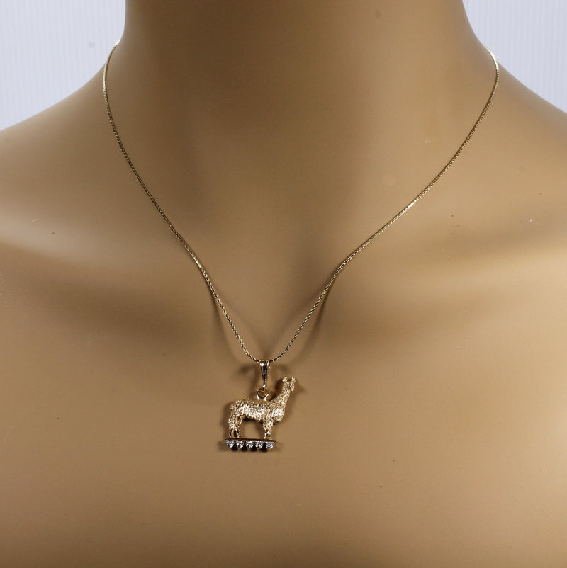"Suri Alpaca Necklace on lighted stage with Diamonds on 18"" chain"
