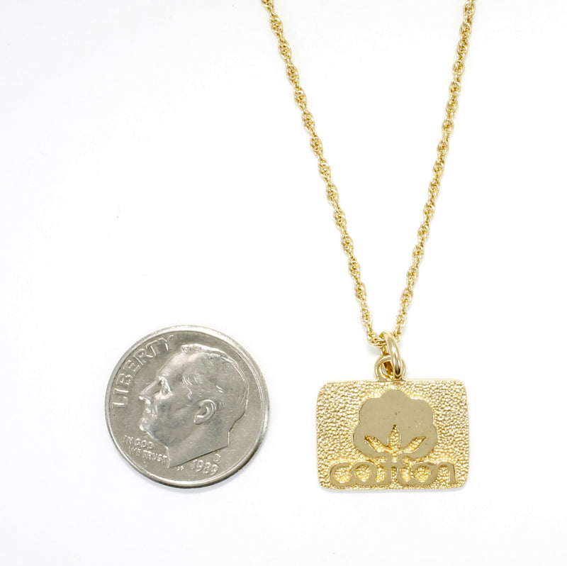 Small Gold Cotton Inc Necklace with Seal of Cotton Logo