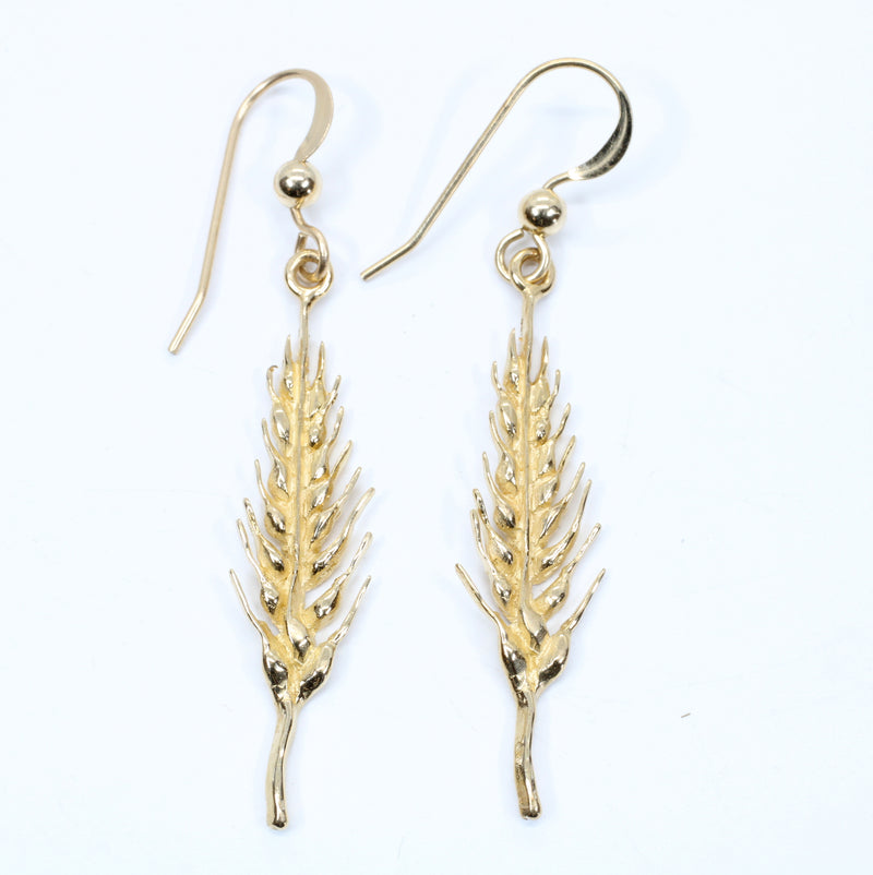 14kt Yellow Gold Wheat Earrings dangling on wires for wheat grower