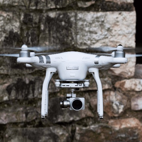 Gadget drone against brick wall background