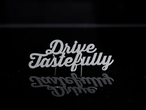 Drive Tastefully grill badge emblem