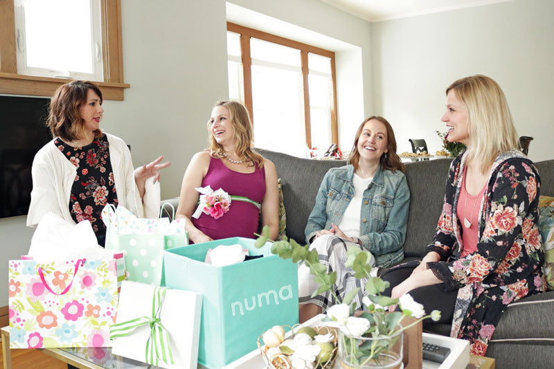 baby shower picture - women in a circle talking with numa kit in the foreground