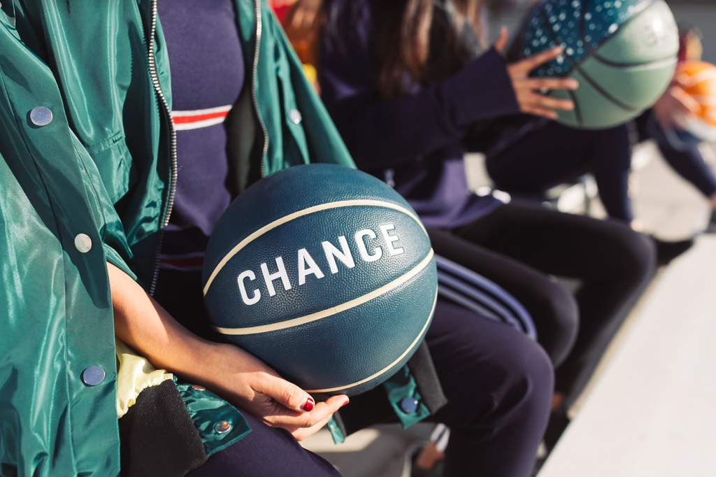 Close up of hands holding Chance Basketball in adult size