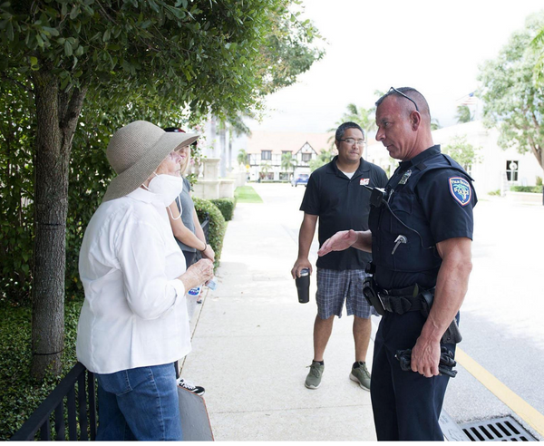 Leta Austin Foster talks to a police officer while protesting the death of George Floyd