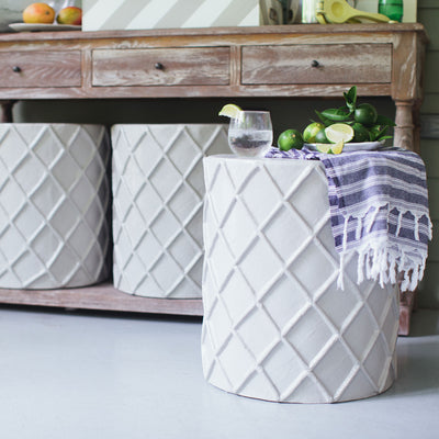 stylish stool/accent table clad in papier mache on porch