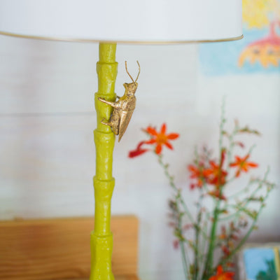 Gold Bug Lamp is handmade from paper mache and has a matal shade