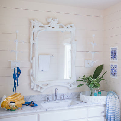 Magalie Mirror in a beachy bathroom, artisan made from papier mache.