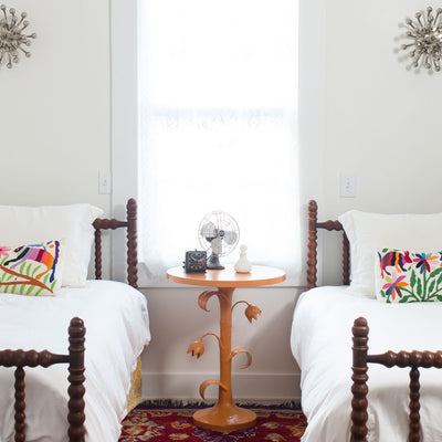 orange tulip table in sweet bedroom