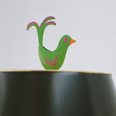 Green bird finial on black Mrs English light by Stray Dog Designs